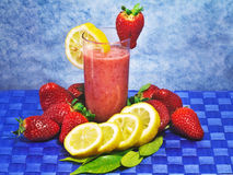 Strawberry and lemon soft drink Stock Images