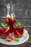 Strawberry lemonade with fresh mint and lemon in glass beakers Stock Images