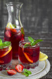 Strawberry lemonade with fresh mint and lemon in glass beakers Stock Image