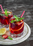 Strawberry lemonade with lemon and mint in glass beakers Royalty Free Stock Image