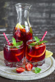Strawberry lemonade with lemon and mint in glass beakers Stock Image
