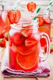 Strawberry lemonade with lime and ice in mason jar Royalty Free Stock Images
