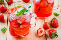 Strawberry lemonade with lime and ice in mason jar Royalty Free Stock Image