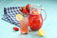 Strawberry lemonade sweaty glass and the glass jar Stock Photography