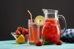 Strawberry lemonade sweaty glass and the glass jar Royalty Free Stock Photos