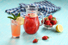 Strawberry lemonade sweaty glass and the glass jar Royalty Free Stock Image