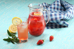 Strawberry lemonade sweaty glass and the glass jar Royalty Free Stock Photography