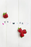 Strawberry Letters cut out from the Magazine Royalty Free Stock Photography