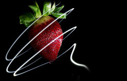 Strawberry Swirl. A strawberry painted with a swirl of light Royalty Free Stock Photography