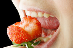 Strawberry in lips Royalty Free Stock Photography