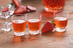 Strawberry liqueur on the table Royalty Free Stock Photo