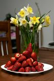 Strawberry. Little pile strawberry and narcissus Stock Photo