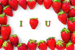 Strawberry look like heart shape, It is mean I LOVE YOU. Group of strawberries are arranged as frame with shadow. On white background stock photos