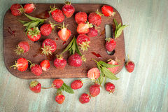 Strawberry loose on a wooden kitchen Boards Stock Photo