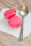 Strawberry  macaroons with spoon Stock Images