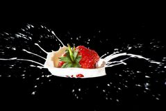 Strawberry Making A Splash Stock Image