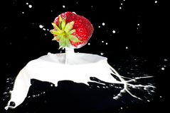 Strawberry Making A Splash Stock Photos