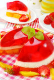 Strawberry and mango jelly with cream Royalty Free Stock Photos