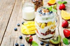 Strawberry, mango, kiwi, blueberry, orange with Greek yogurt and Royalty Free Stock Photos
