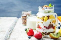 Strawberry, mango, kiwi, blueberry, orange with Greek yogurt and. Granola in a jar. toning. selective focus royalty free stock photos