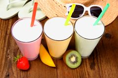 Strawberry, mango, kiwi smoothie and holiday background Stock Photos