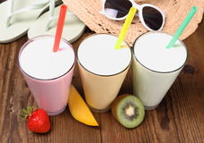 Strawberry, mango, kiwi smoothie with holiday background Stock Image