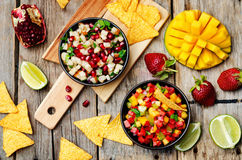 Strawberry mango pepper and pomegranate pear salsa Royalty Free Stock Photo