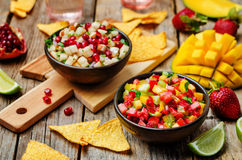 Strawberry mango pepper and pomegranate pear salsa Stock Photos