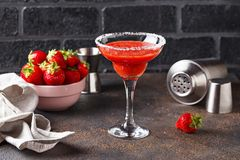 Strawberry Margarita cocktail in glass. Summer alcoholic strawberry Margarita cocktail in glass royalty free stock images