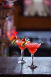 Strawberry margarita cocktail. Two strawberry margarita cocktails on the wooden bar Stock Photos