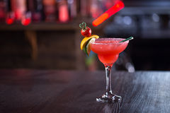 Strawberry margarita cocktail. On the wooden bar garnished with lime, lemon and strawberry Royalty Free Stock Photos