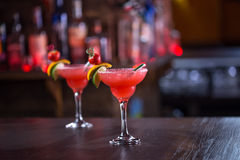 Strawberry margarita cocktails. Two strawberry margarita cocktails on the wooden bar Stock Images