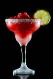 Strawberry margarita. Frozen strawberry margarita isolated on a black background garnished with a salt rim and a lime wheel royalty free stock photos