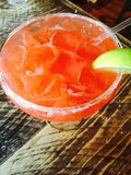Strawberry margarita on the rocks. Sugar rim, lime, ice Stock Photography