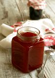 strawberry marmalade in glass on wooden Royalty Free Stock Image