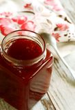 strawberry marmalade in glass on wooden Royalty Free Stock Photography