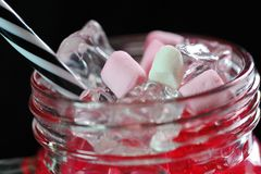 Marshmallows in the cocktail glass royalty free stock images