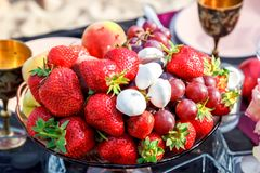 Strawberry and marshmallow on the table royalty free stock image