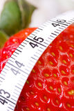 Strawberry with measure tape Royalty Free Stock Photo