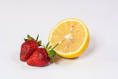 When Strawberry Meet Lemon. Strawberry and Lemon with white background stock images