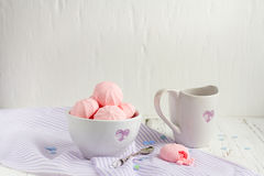 Strawberry meringue cookies. Breakfast with strawberry meringue cookies on a white table Royalty Free Stock Images