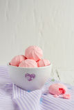 Strawberry meringue cookies. On a white table Stock Images