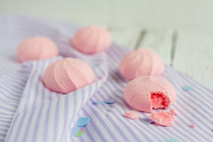 Strawberry meringue cookies. On a white table Royalty Free Stock Photography