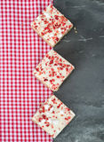 Strawberry and meringue topped flapjack on gingham cloth. Strawberry and meringue topped flapjack Royalty Free Stock Photo