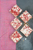 Strawberry and meringue topped flapjack on gingham cloth. Strawberry and meringue topped flapjack Royalty Free Stock Photos