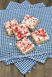 Strawberry and meringue topped flapjack on gingham cloth Stock Images