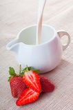 Strawberry with milk Royalty Free Stock Photography