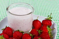 Strawberry Milk. And dish of red, ripe strawberries Stock Images