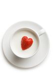 Strawberry in milk. Over view of red ripe strawberry inside cup of milk Stock Photo