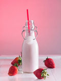 Strawberry milk in a bottle Stock Images